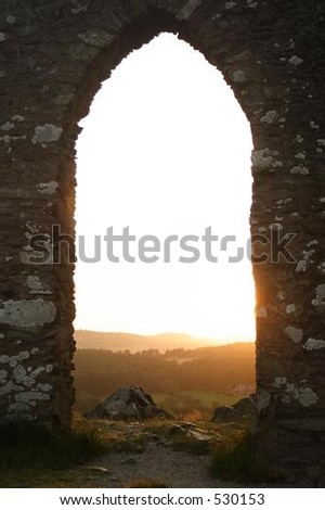 an old archway with a view - stock photo