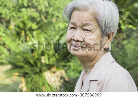 an old asian healthy woman is smiling - stock photo