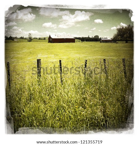 An old barn in rural scene - stock photo