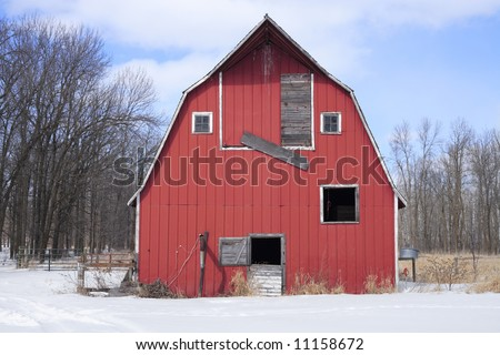 An old barn on a cold winter day. - stock photo