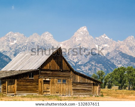 An old barn on Mormon Row with the Tetons behind in the Antelope Flats area of Grand Teton National Park, Wyoming - stock photo