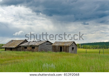 An old barn over a fantastic cloud sky view and mountain