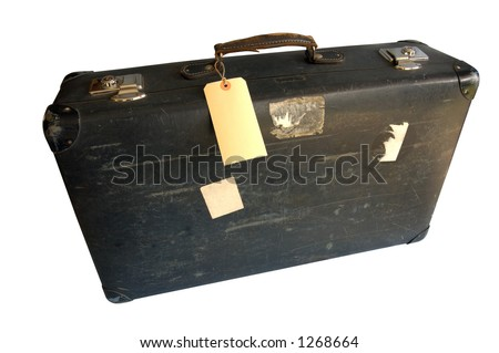 An old, battered leather suitcase with a blank label tied to the handle. Space for text on the label.