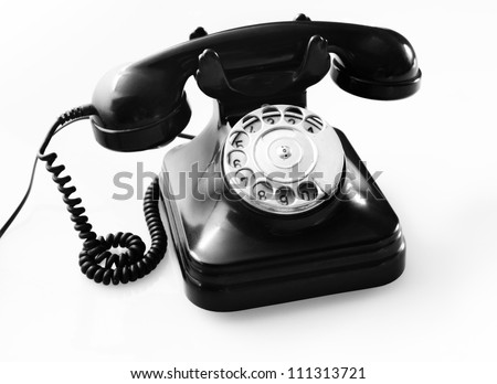 an old black telephon with rotary dial - stock photo