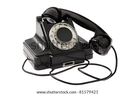An old black vintage rotary style telephone off the hook isolated over a white background - stock photo