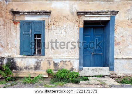 An old blue-green window and a door