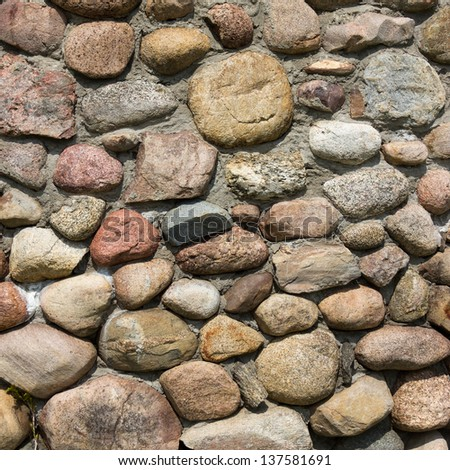 An old boulder stone wall - stock photo
