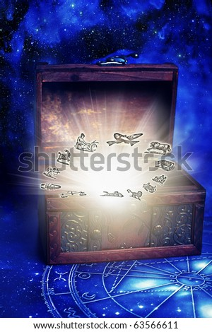 an old box with glow and symbols of zodiac - stock photo
