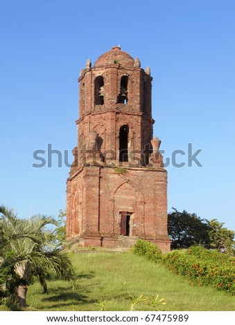 An old brick bell tower in the Philippines - stock photo