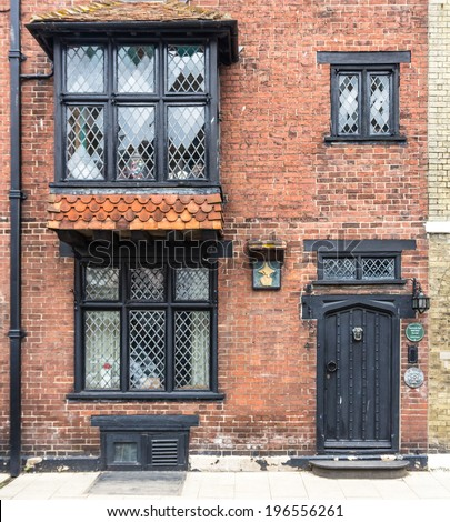 An old brick house with black painted door seen in Rye, Kent, UK - stock photo