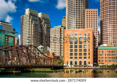 An old bridge and the Boston Skyline, seen from Fort Point. - stock photo