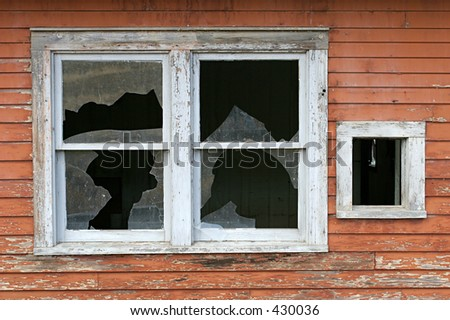 an old, broken window on a wooden home ca. 1940s - stock photo