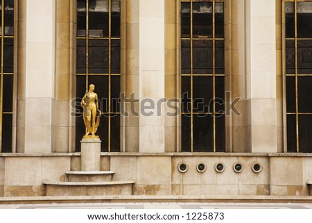 An old building with golden statues in Paris, France.