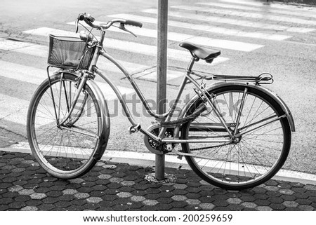 an old bycicle in a tranquil italian city - stock photo
