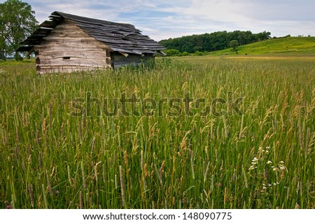 An old cabin from another time on the prairie in Glacial Park Conservation Area, McHenry County, Illinois. - stock photo