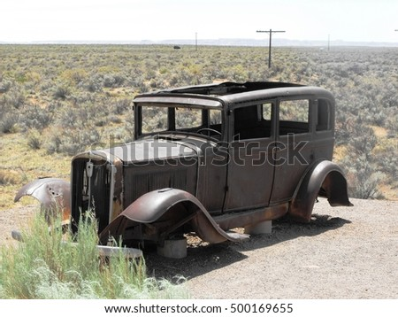 An old car abandoned in the Petrified National Park Arizona