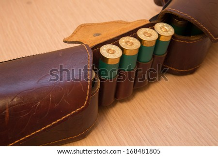 An old cartridge leather belt with shotgun shells - stock photo