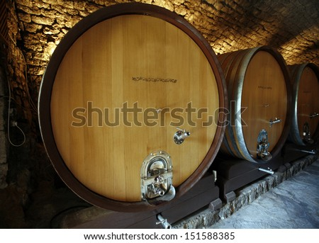 An old cellar of a traditional wine producer  - stock photo