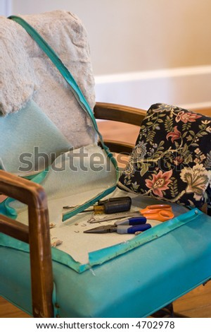 an old chair ready to be reupholstered - stock photo