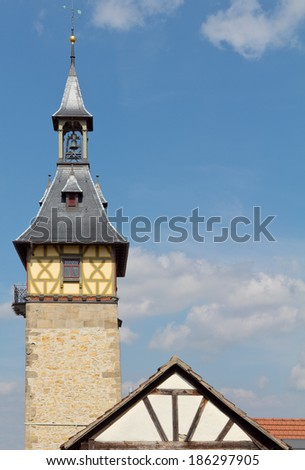 An old city tower against blue sky in Germany - stock photo