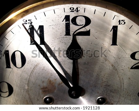 an old clock-face close to midnight - stock photo