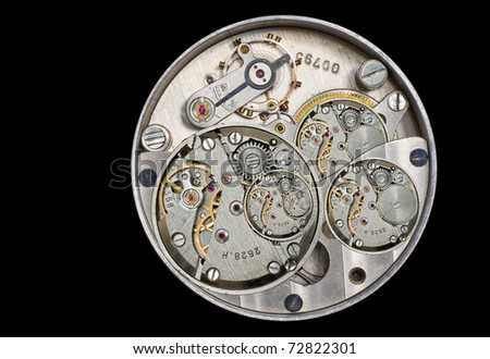 An old clockwork as a mix of different details. - stock photo