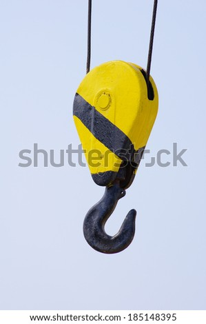 An old Crane Hook on blue sky  - stock photo