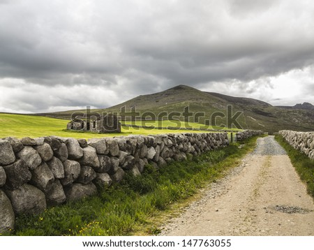 an old derelict house in a country setting in the mournes ireland - stock photo