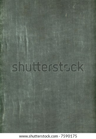 An old, distressed cloth book-cover, suitable for use as a background texture. - stock photo