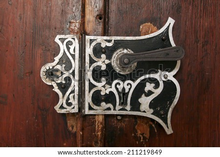 An old door handle in a castle - stock photo