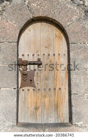 an old door of a castle at lanzarote - stock photo