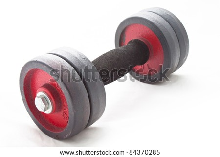 An old dumbbell on white background - stock photo