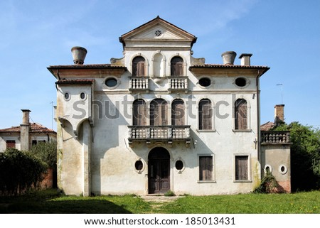 An old dwelling in the park of Villa Pisani, a large historical residence located in the town of Stra in the northeast of Italy, between Padua and Venice - stock photo