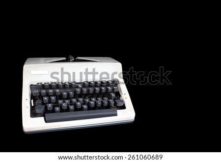 An old electronic typewriter, isolated against black with blank space for text.  - stock photo