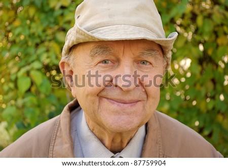 an old farmer in backyard - stock photo