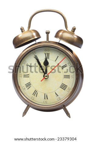An old fashioned alarm clock at five minutes to twelve isolated on white with clipping path