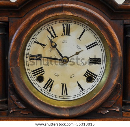An old fashioned antique clock - stock photo