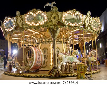 An old fashioned carousel at night. - stock photo