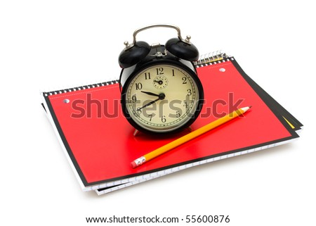 An old fashioned clock on a books isolated on a white background, Time to go back to school