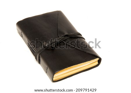 An old fashioned leather bound blank journal closed with cord wrapped around it, shot over white. - stock photo