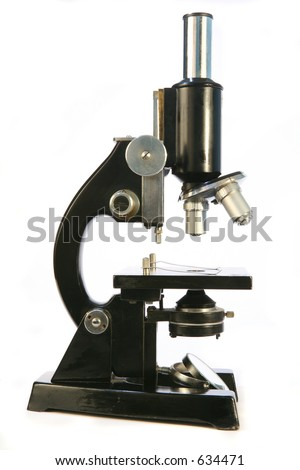An old-fashioned microscope, of the type used in scientific or medical research in the latter part of the 20th Century. - stock photo