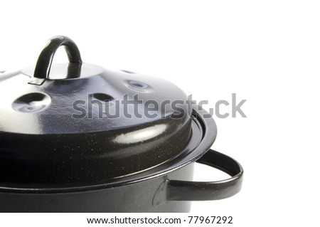 an old fashioned pan for cooking close up on a white background