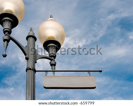 An old fashioned street lamppost with a sign ready for your name. - stock photo