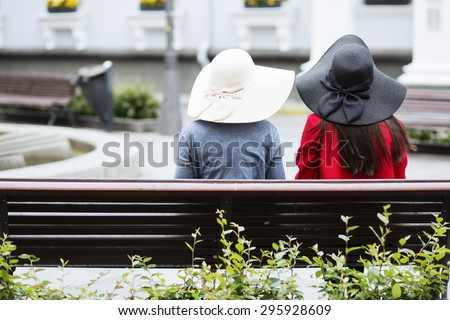 An old-fashioned style couple on the bench - stock photo