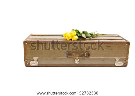 an old fashioned suitcase isolated on white