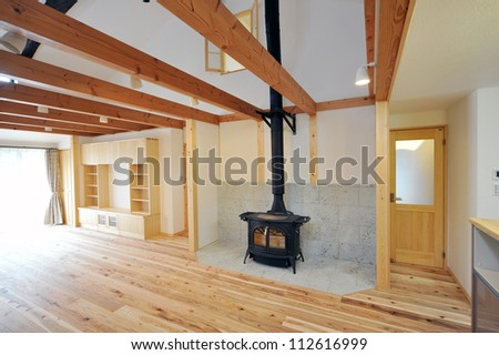 An old fashioned wood burning stove with a roaring fire-1-3 - stock photo