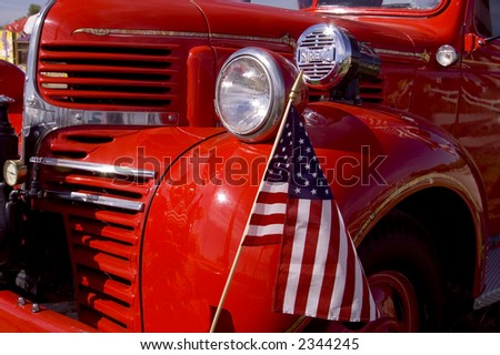 An old firetruck on the forth of July. - stock photo