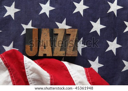an old flag with the word jazz in old, ink-stained wood type - stock photo