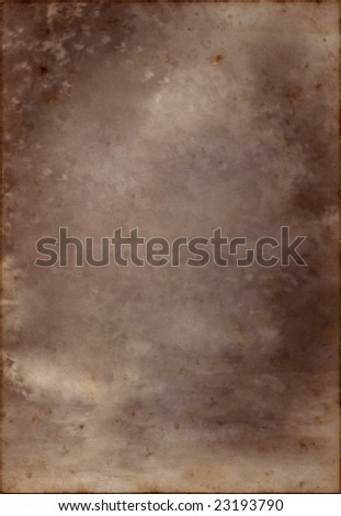 An old flecked piece of parchment, suitable as a background texture. - stock photo