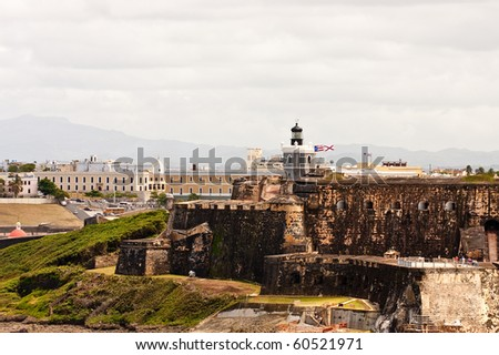 An old fort and modern stucco buildings on the coast of Puerto Rico